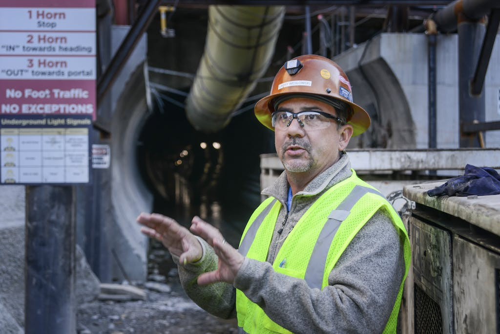 Employee in front of tunnel