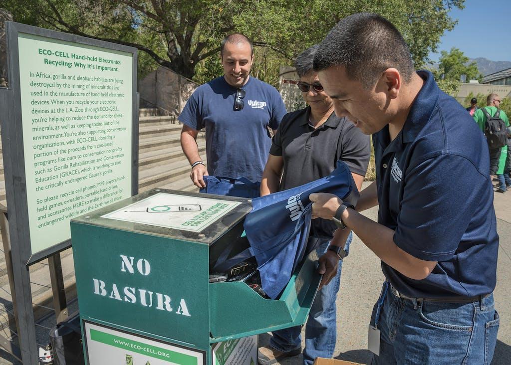 Men making a clothes donation